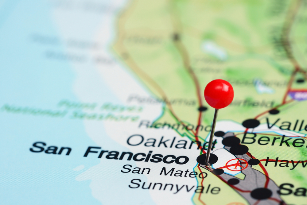 A close up of San Francisco on a U.S. map with a red pushpin to mark the spot. Other city names surround it, including Oakland, San Mateo and Sunnyvale.